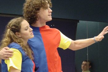 Monica Yudovich (Sylvie) and Joshua Park (Phil) in the 2004 NYMF production. (Photo by Stephen Nachamie)